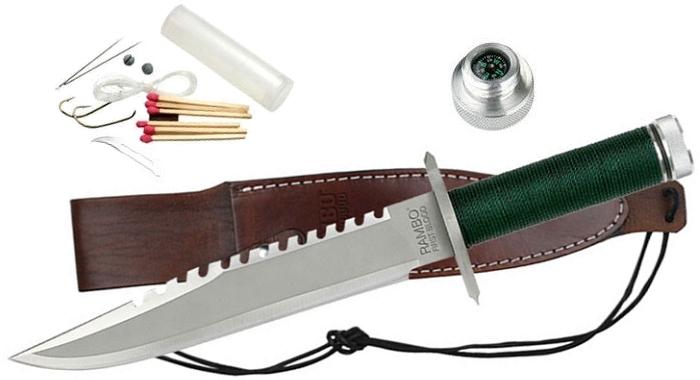 Das Rambo Messer auf der Lederscheide liegen (alles Zubehör mitinbegriffen)